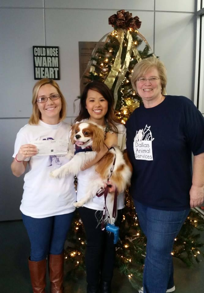 Nina Pham, holding her dog Bentley, visited Dallas Animal Services Monday.