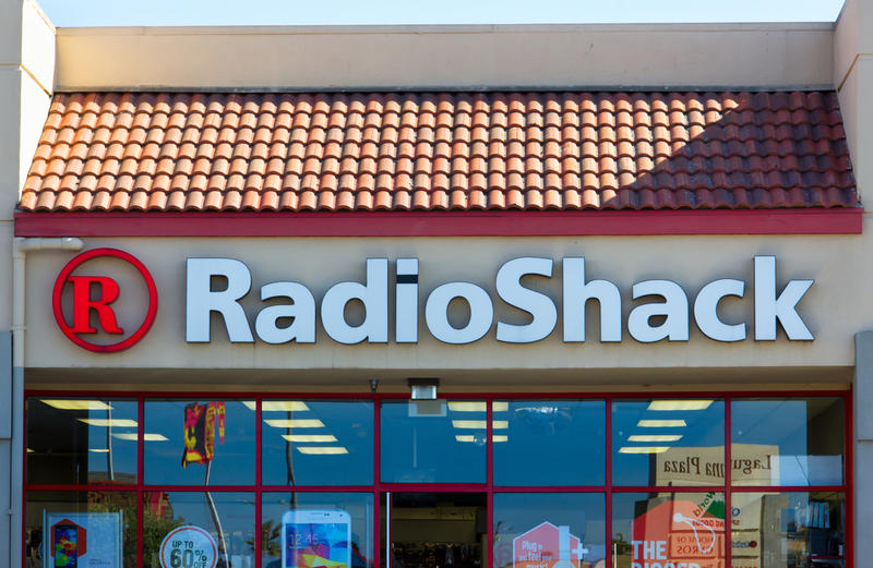 RadioShack's third-quarter loss widened, sales dropped for the eleventh consecutive quarter and the Fort Worth-based electronics retailer announced more cost cuts to stay afloat.