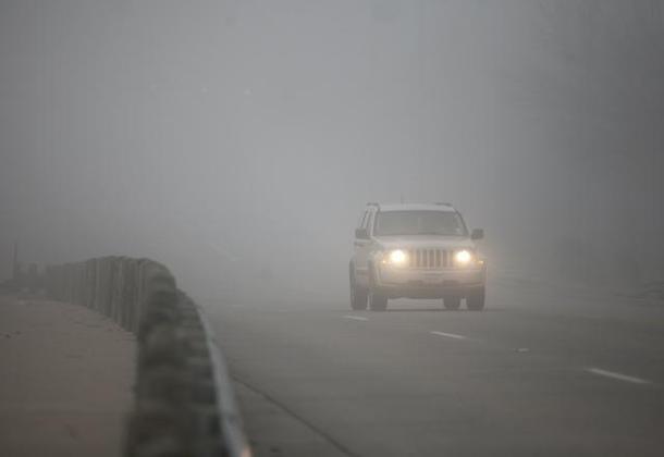 A car drove through dense fog in Arlington Tuesday morning.