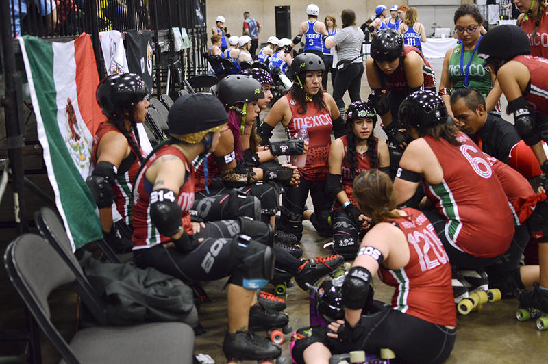Team Mexico huddles up on day one of the Roller Derby World Cup.