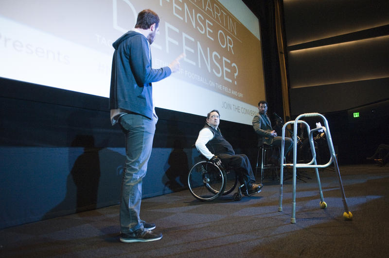 "Members of the Dallas Theater perform a portion of the company's upcoming production ""Colossal"" during a panel discussion about football and ethics."