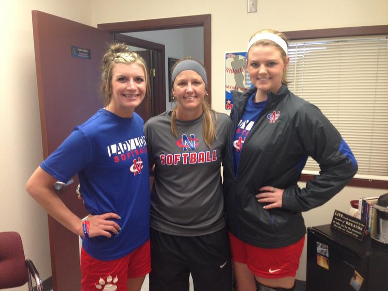 Assistant coach Taylor Christian poses with Bailey Buchanan and Rachel Hitt, two softball players who were on the bus when an 18-wheeler crashed into the team bus in September.