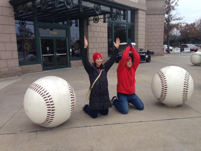 Two OSU fans taking advantage of Rangers ballpark baseballs to spell out OHIO.