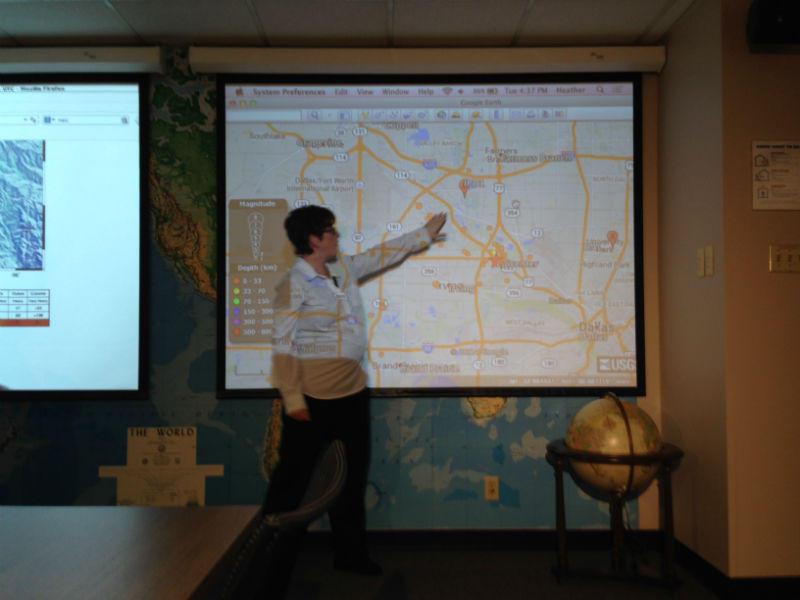SMU seismologist Heather DeShon pointed to a map showing locations of recent earthquakes.