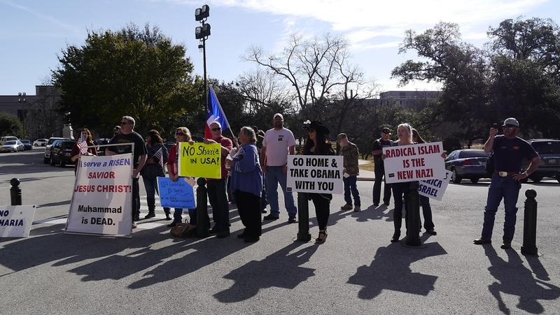 "Protesters say they want Texas Muslims to abide by the U.S. Constitution, ""not by Sharia law."""