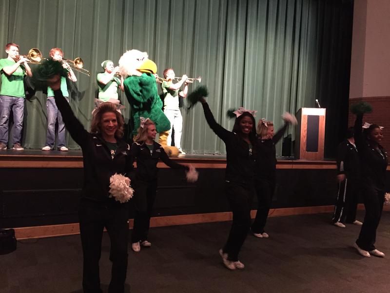 UNT cheerleaders and band members peform alongside Scrappy the Eagle mascot at Arlington High School Tuesday morning.