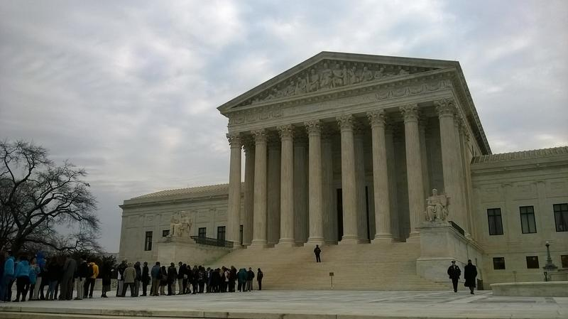 In Washington DC, visitors line up to enter the US Supreme Court. Oral arguments were heard Wednesday morning in Texas Department of Housing and Community Affairs v. The Inclusive Communities Project.