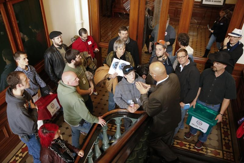 Senate Sergeant at Arms Rick DeLeon tells a group from Lone Star Gun Rights that they are not allowed in the secure back hall of the Senate on opening day Jan. 13.