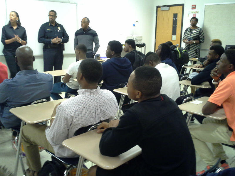 """Dozens of Lancaster students participated in Wednesday night's """"Project S.O.S.,"""" which featured Dallas County Constable Roy Williams (center)."""