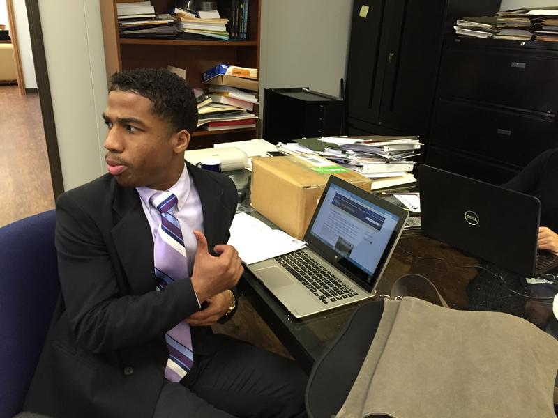 Paul Quinn College freshman Kevin Lee at work in the president's office