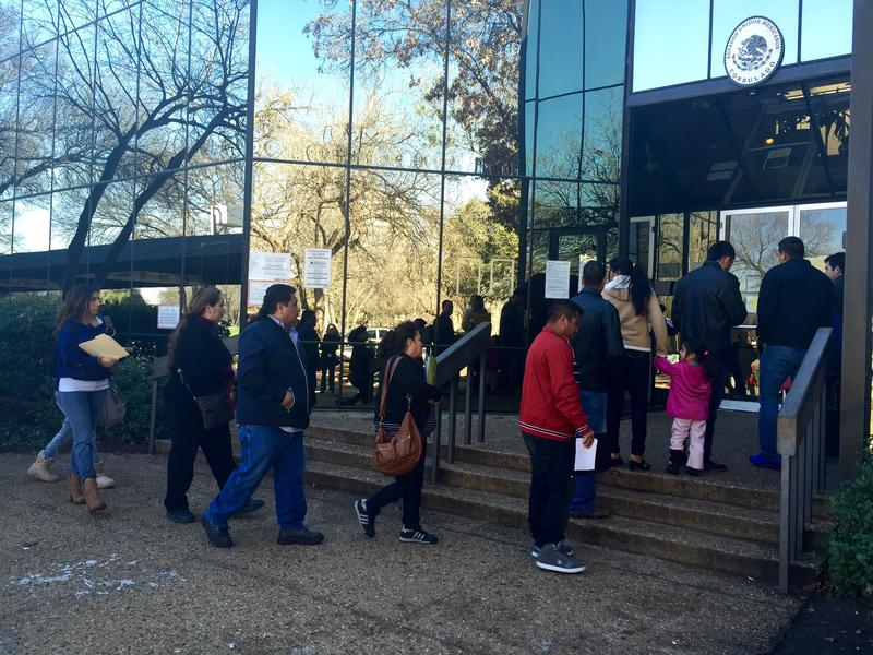A line of people wait outside the Mexican Consulate in Dallas on Wednesday.