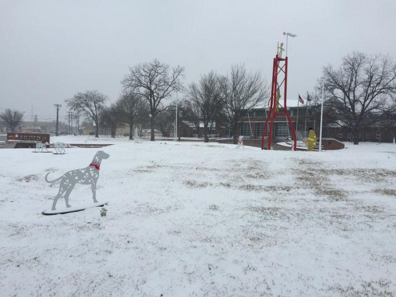 Snow covers a fire station in Plano.