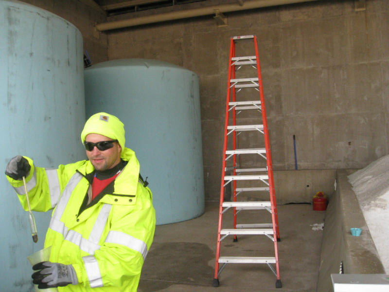 "Jason Skidmore, NTTA maintenance supervisor and ""brine master,"" holding beaker used to prepare the precise mix of salt and water that'll be sprayed on icy toll roads"