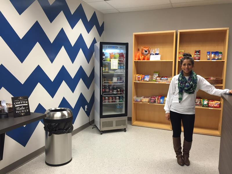 Araceli Cadena, coordinator of recruitment and advising at Universities Center, stands inside the new student store. A&M Commerce's new digs are connected to the original Universities Center building on Main Street by a pedestrian walkway.