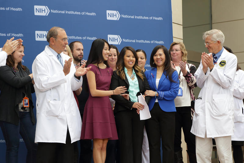 Nina Pham celebrates her recovery from Ebola with family and medical staff at a National Institutes of Health press conference.