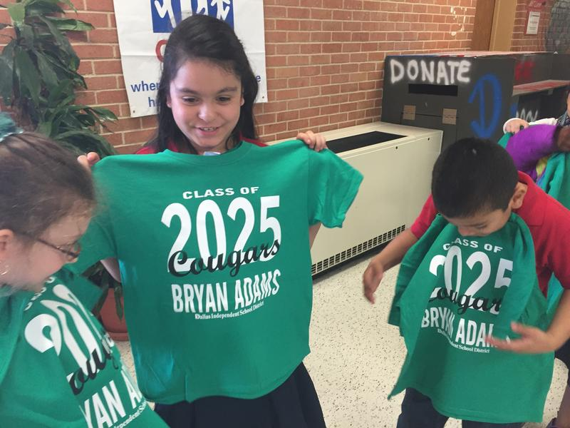 Second graders show off their class of 2025 t-shirts