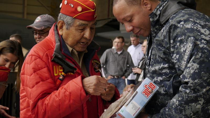 Peter MacDonald, Sr. of The Navajo Nation signs a toy for a fan at NAS Fort Worth JRB.