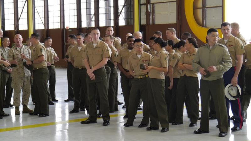 Men and women at NAS Fort Worth JRB prepare to receive Navajo Code Talkers inside an aircraft hangar.