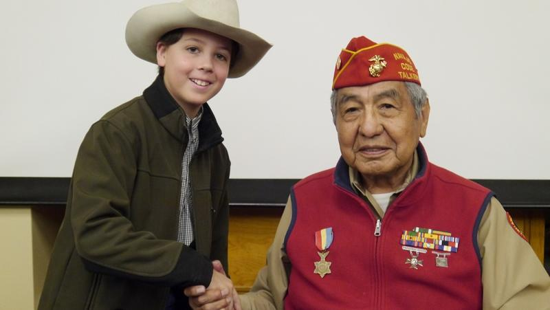 Ridge Roberts of Granbury visits with Navajo Code Talker Peter MacDonald Sr. at the NAS Fort Worth JRB.