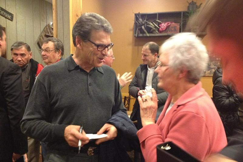 Former Governor Rick Perry campaigns at a Pizza Ranch in Indianola, Iowa.