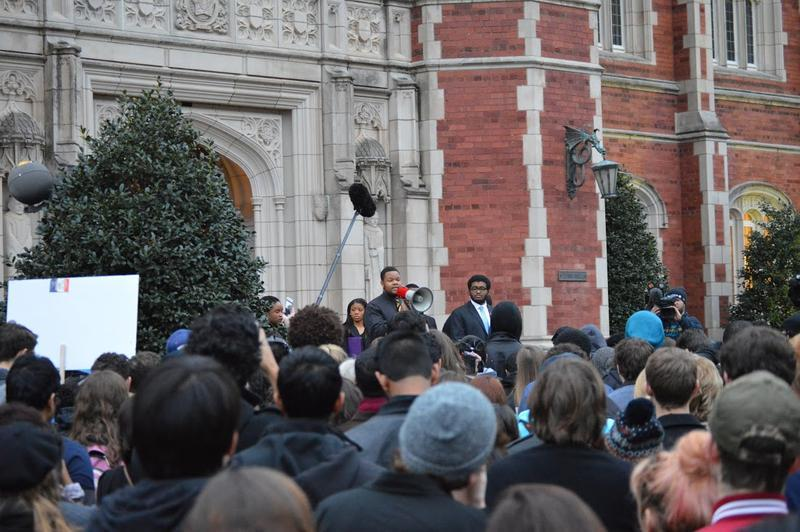 Demonstrators gather outside Evans Hall on the University of Oklahoma campus Monday morning to protest the video with racist chants allegedly performed by Sigma Alpha Epsilon fraternity members.