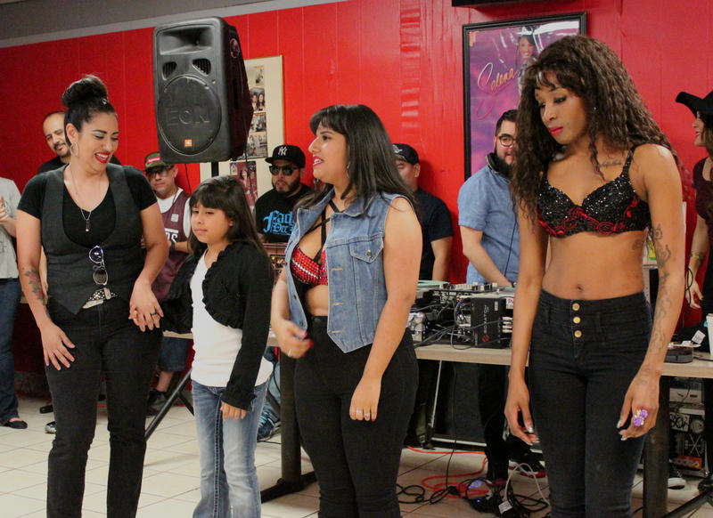Girls lined up for the Selena look-a-like contest. The mother-daughter duo on the left took the crown.