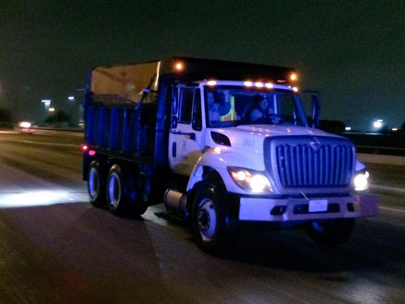 In Dallas, city trucks were out in force to sand slick roads.