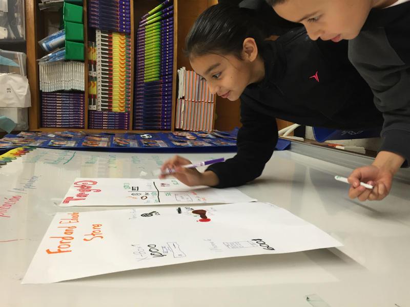 Students work on a social studies project in Irma De La Guardia's classroom.