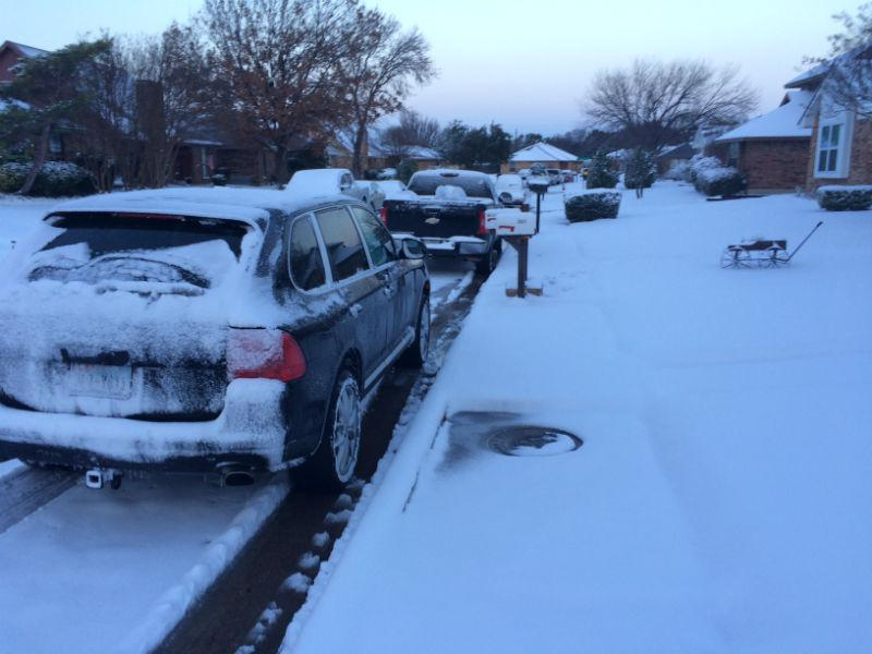 Cars were covered with snow and ice in North Dallas Thursday morning.