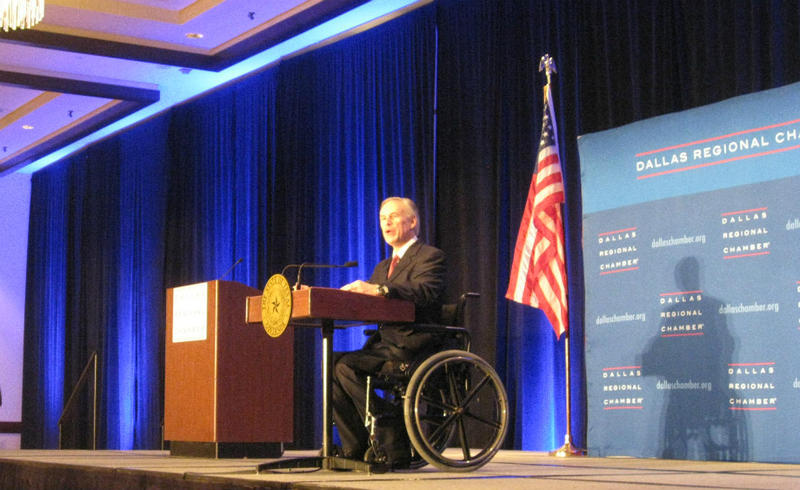 Texas Governor Greg Abbott delivering his state of the state speech to a packed Dallas ballroom of chamber of commerce members