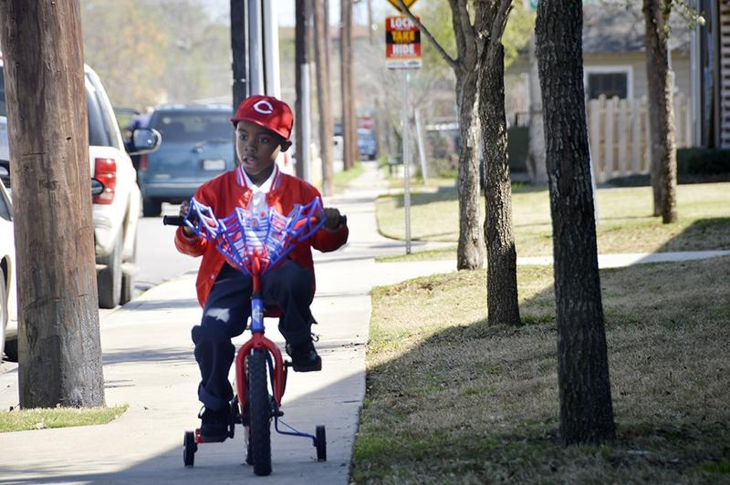 Jayden tries out his new bike, a gift from a family in Farmers Branch.