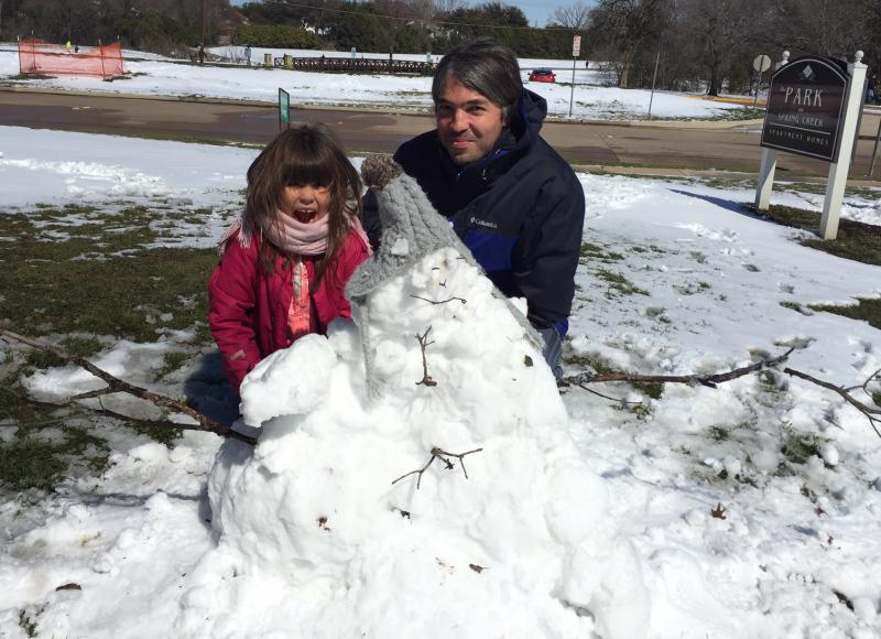 Ugurcan Isik and his 6-year-old daughter, Doga, went outside at noon to play in the snow. The Isiks are from Turkey -- they moved here a year ago -- and say they're used to seeing snow, but this is the first time they've seen this much of it in Plano.
