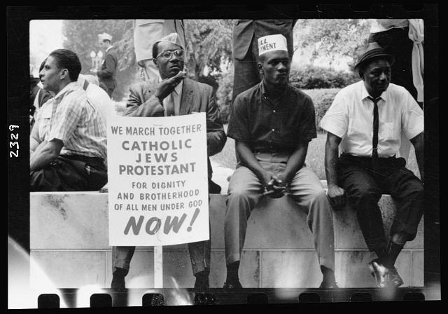 Participants in the 1965 march from Selma to Montgomery, Alabama take a rest.