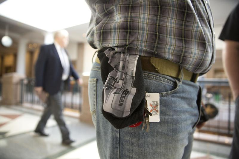 Jason Orsek with Come and Take it America wears a cloth gun holder with a photo of a gun imprinted on it at the Texas Capitol on Feb. 12, when the Senate Committee on State Affairs heard testimony on gun-related bills.