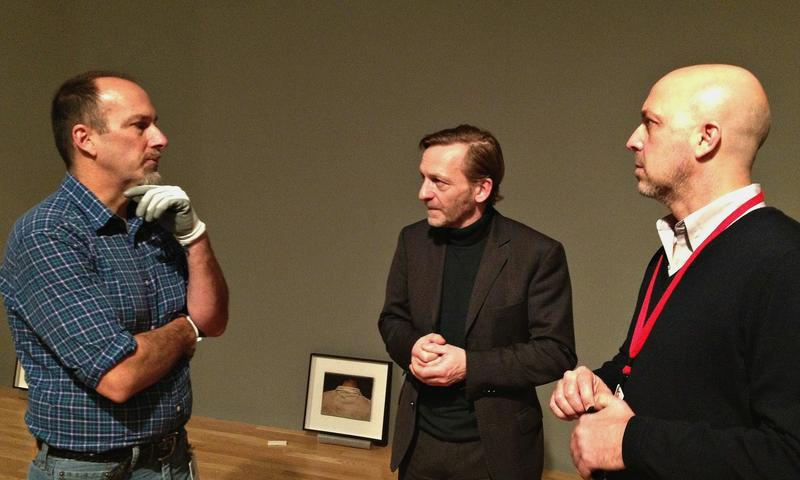 Mike Hill, a DMA preparator, artist Michael Borremans and curator Jeffrey Groves (l to r) during the installation of 'As Sweet As It Gets.'