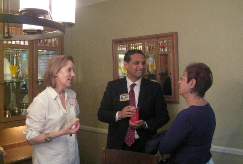 From left: host Jeanne Culver, school board candidate Edwin Flores and undecided voter Sari Bahl.