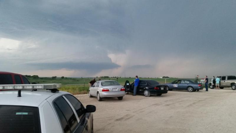 Storm watchers gathered in southwestern Johnson County Sunday evening to watch the storms rolling through the area.