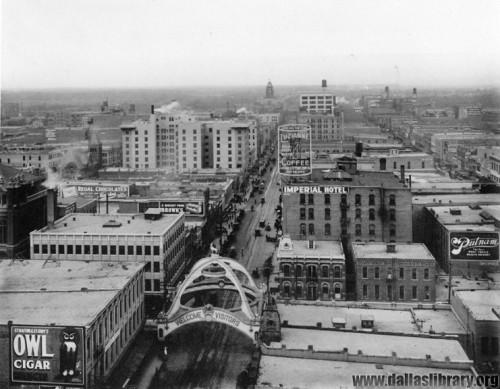 Aerial view looking east from the Praetorian Building, Dallas's first skyscraper, 1910. The Elks Arch would be moved to Fair Park the following year.