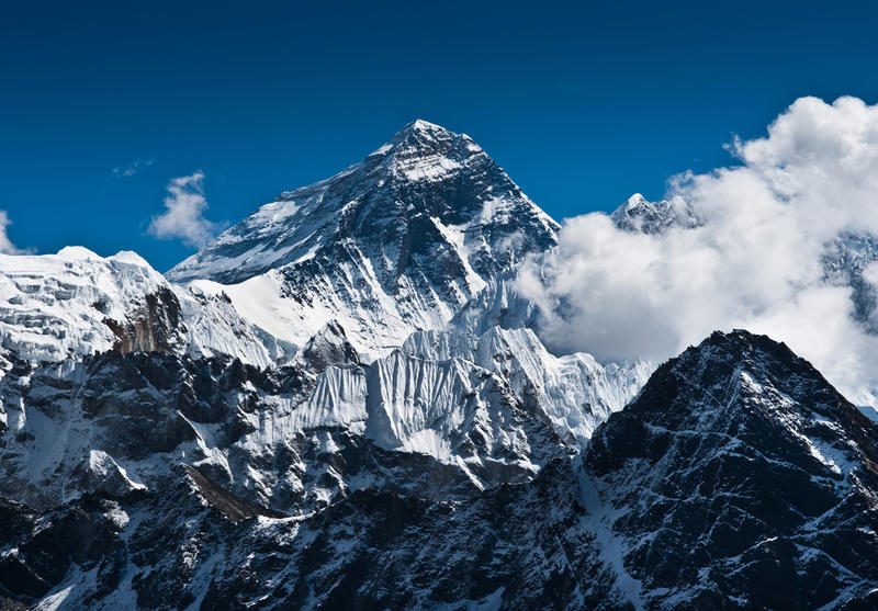 A North Texas woman who survived a Mount Everest avalanche triggered by a 7.8 -magnitude earthquake in Nepal is trying to get home.