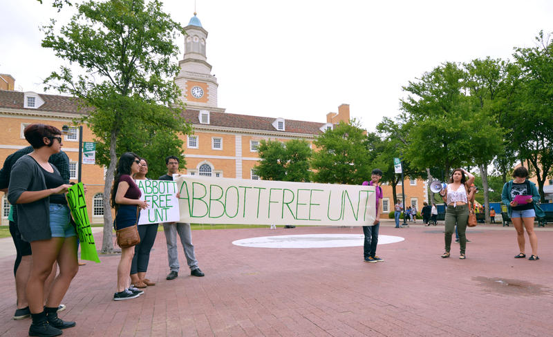 UNT students against Greg Abbott's selection as commencement speaker at a rally a few weeks before the event.