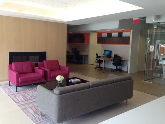 The casual sitting area outside the computer lab space features a chic fireplace.