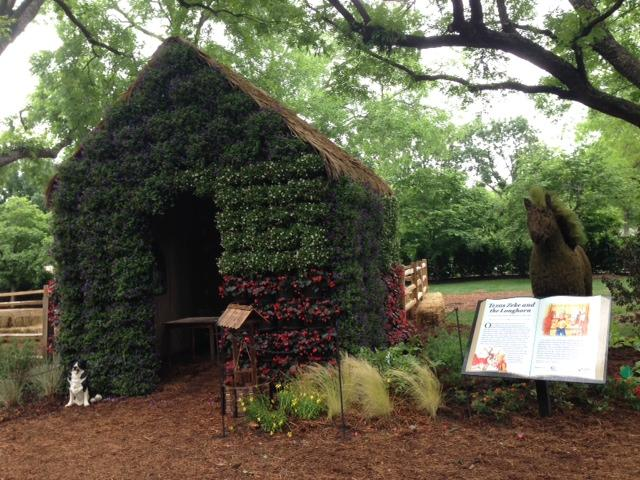 This flower house sits next to the story of Texas Zeke and the Longhorn.