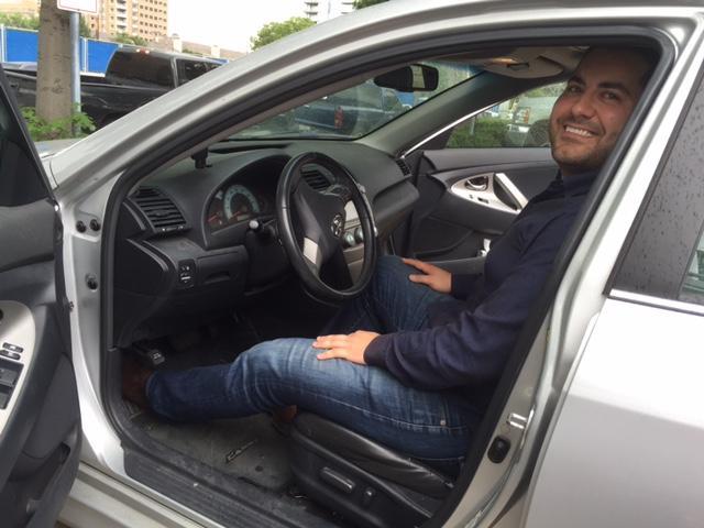 Vinli's CEO Mark Haidar in a 2007 Toyota Camry.