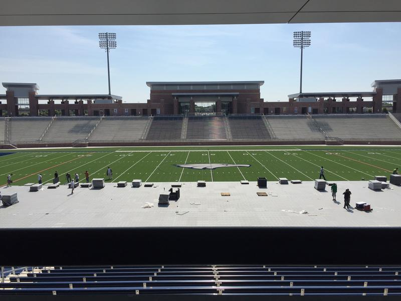 Workers set up for Allen High School's graduation ceremony in Eagle Stadium.