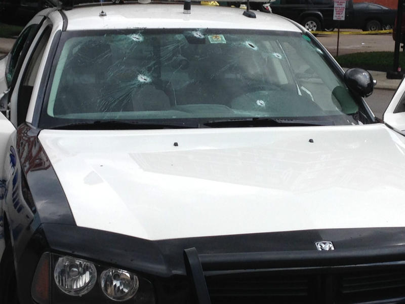 This was one of several cars attacked by the lone gunman overnight at Dallas Police headquarters. No one was injured.