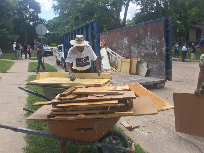 People cleaning up in Garland neighborhood Friday, June 12.