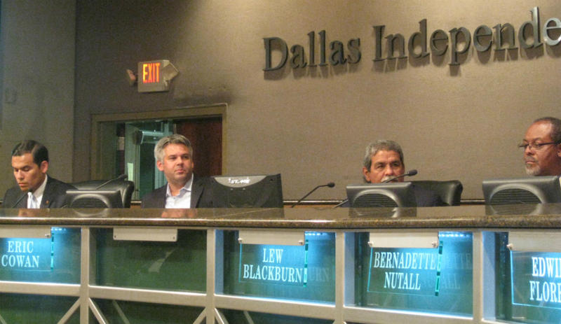 Michael Hinojosa takes his old seat, second from right, in the horseshoe at the Dallas ISD administration building.