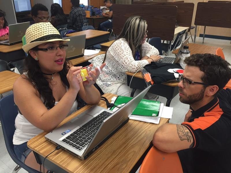 Fernanda Zarrarz talks to English teacher Paul Blankenship about her essay. Under a new state law, students who've failed one or two STAAR exams can graduate if they complete certain projects and meet other requirements.