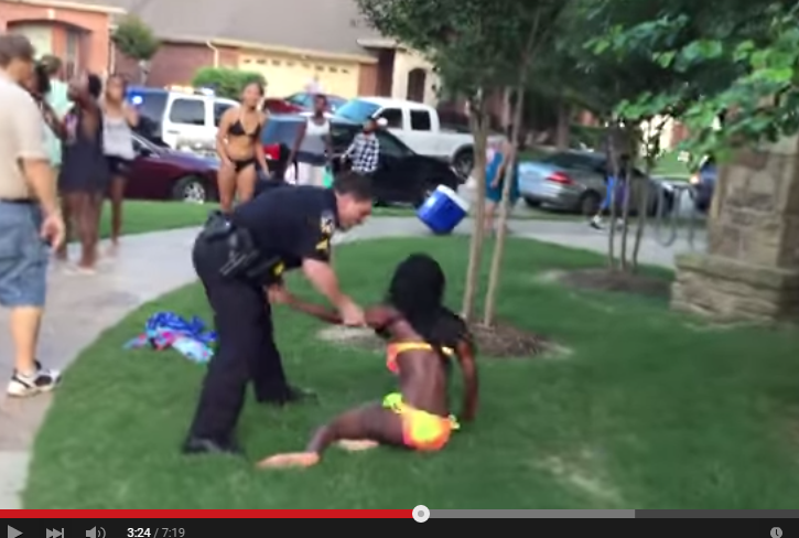 A video posted on YouTube shows a McKinney police officer pushing a 14-year-old girl in a swimsuit to the ground outside a pool and pointing his gun at other teens.