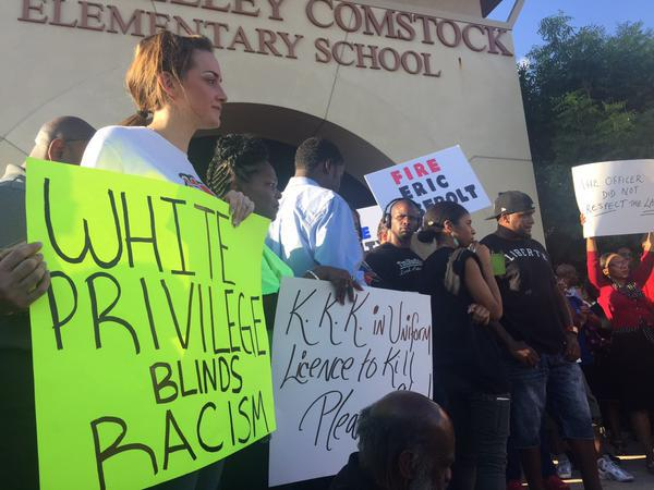 Hundreds gathered outside a McKinney elementary school to protest a white police officer's actions caught on video Friday.